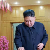 North Korean leader Kim Jong Un casts his ballot for elections to the Supreme People's Assembly on Sunday in Pyongyang. | AFP-JIJI