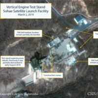 The Sohae Satellite Launching Station features what researchers have described as a vertical engine test stand, partially rebuilt with two construction cranes, in a commercial satellite image taken over Tongchang-ri, North Korea, on March 2. | REUTERS