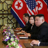 North Korean leader Kim Jong Un and U.S. President Donald Trump look on during their second summit meeting in Hanoi on Feb. 28. | REUTERS