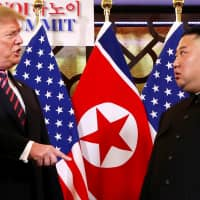 With a piece of paper, Trump called on Kim to hand over all nuclear, chemical and biological weapons