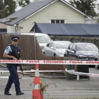 A police officer stands guard outside the Linwood mosque in Christchurch, New Zealand, Tuesday. Four days after Friday's attack, New Zealand's deadliest shooting in modern history, relatives were anxiously waiting for word on when they can bury their loved ones. | AP