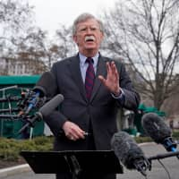 U.S. President Donald Trump's national security adviser, John Bolton, speaks to reporters at the White House on Friday. | REUTERS