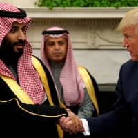 U.S. President Donald Trump shakes hands with Saudi Crown Prince Mohammed bin Salman in the Oval Office at the White House in Washington last March. | REUTERS