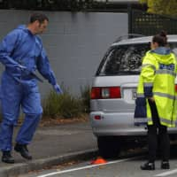 Police forensic staff work outside the Masjid Al Noor mosque in Christchurch, New Zealand, Monday. | AP