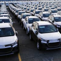 Imported automobiles at the port of Newark in New Jersey | REUTERS
