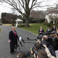 U.S. President Donald Trump speaks to members of the media on the South Lawn of the White House before boarding Marine One in Washington on Wednesday. | BLOOMBERG