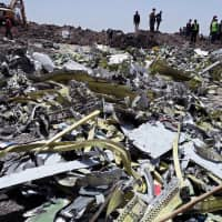 Wreckage is seen at the site of the Ethiopian Airlines Flight ET 302 plane crash, near the town of Bishoftu, southeast of Addis Ababa Monday. | REUTERS