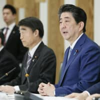 Prime Minister Shinzo Abe speaks at a meeting of Cabinet ministers on the revision of the child abuse prevention law and associated measures at his office in Tokyo on Tuesday. | KYODO