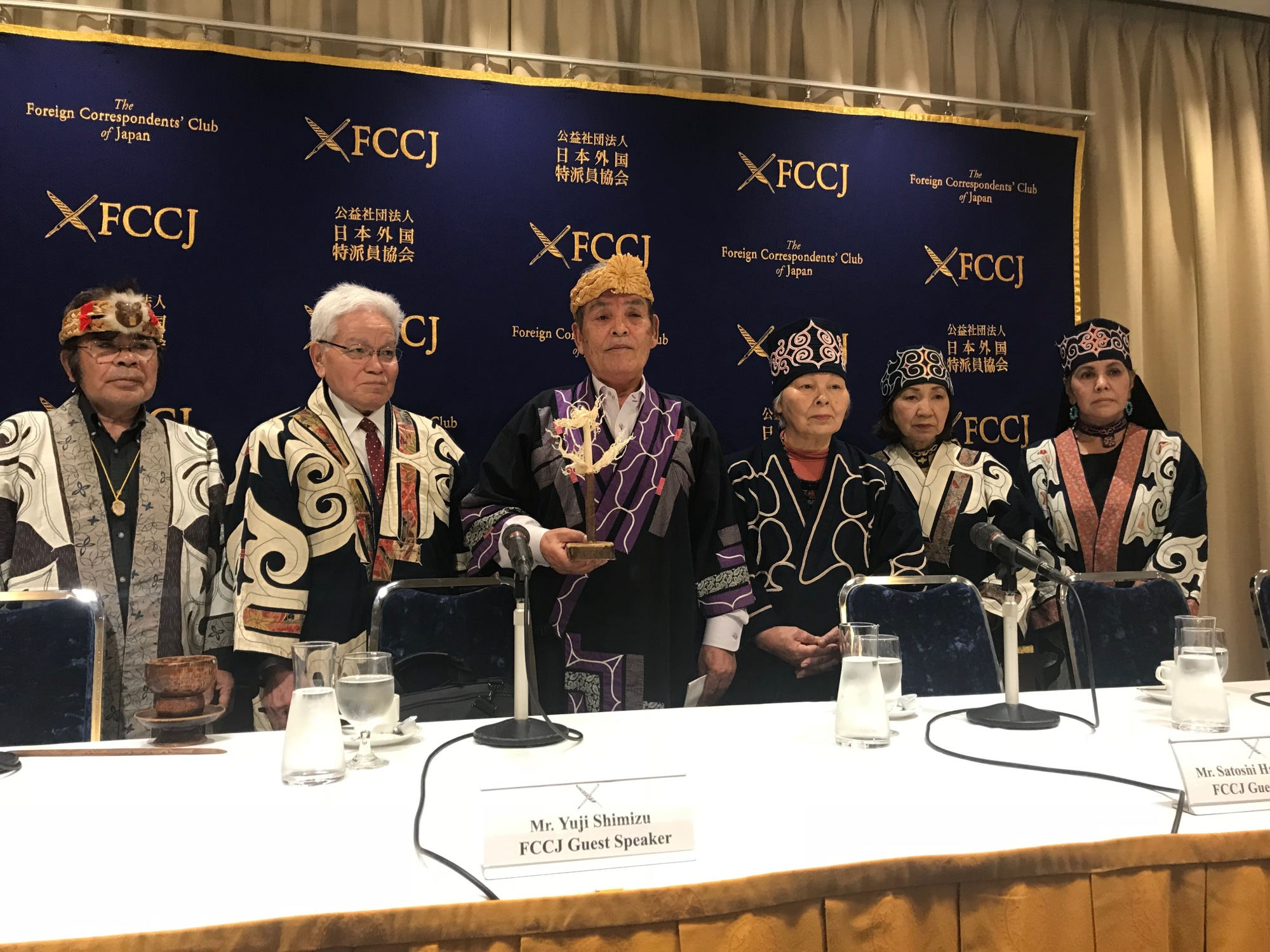 Representatives of Ainu rights groups hold a news conference at the Foreign Correspondents' Club of Japan on Friday. | KYODO