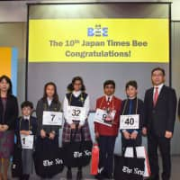 The top five contenders in The Japan Times Bee pose for a photo with executives of The Japan Times and The New York Times on Sunday in Tokyo. | SATOKO KAWASAKI