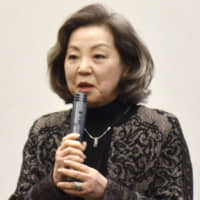 Keiko Takemiya, head of the Japan Society for Studies in Cartoons and Comics, speaks at a meeting held last month to discuss revisions to the copyright law. | KYODO