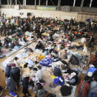 Residents affected by the March 11, 2011, quake and tsunami disasters stay at an evacuation center in Kesennuma, Miyagi Prefecture, on March 13 that year. A recent survey found 77.6 percent of  young people 'feel anxious' about natural disasters. | KYODO