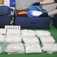 Bags of smuggled stimulant drugs are shown at Narita airport on Monday. | KYODO