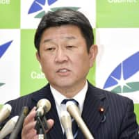Economic policy minister Toshimitsu Motegi speaks during a news conference on Wednesday in Tokyo. | KYODO