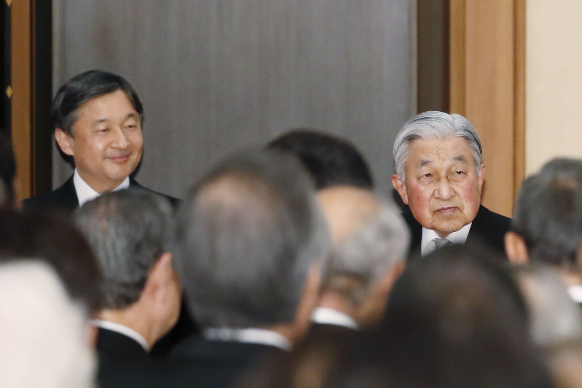 Crown Prince Naruhito and Emperor Akihito attend a tea party at the Imperial Palace in Tokyo on Feb. 25. The event was held to mark the Emperor's 30-year reign.   KYODO