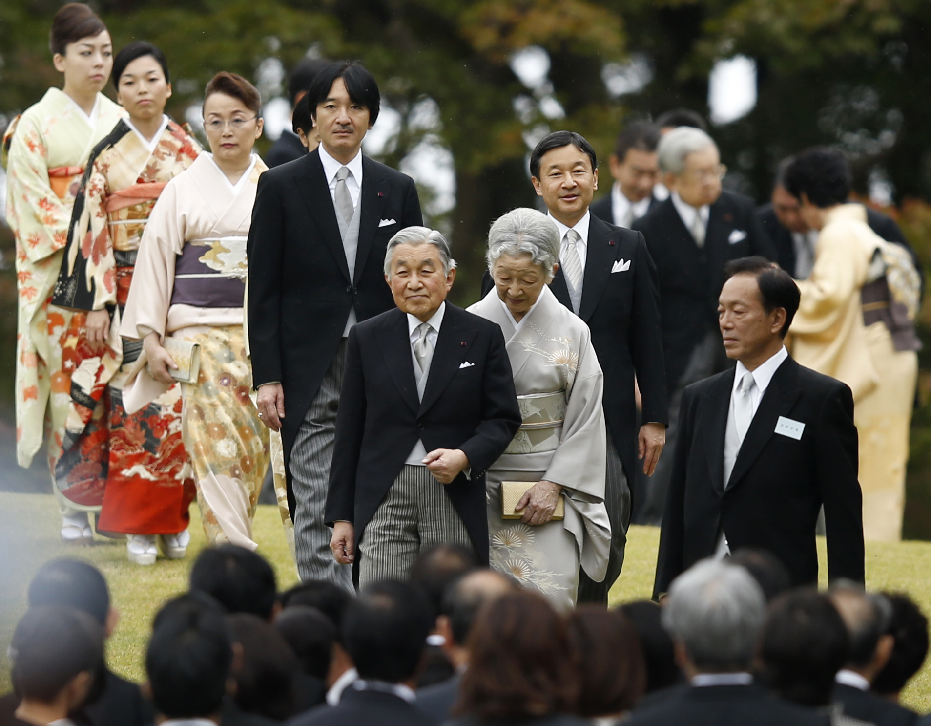 Emperor Akihito is accompanied by Empress Michiko and Imperial family members (from left) Princess Yoko, Princess Akiko, Princess Nobuko, Prince Akishino and Crown Prince Naruhito, as they arrive at the autumn garden party in Tokyo in November 2014. | AP