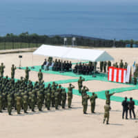 Ground Self-Defense Force troops hold a ceremony in March 2016 to mark the forming of a unit on Okinawa Prefecture's Yonaguni Island, which is located close to Taiwan. The GSDF is bolstering its presence on the prefecture's remote islands. | KYODO