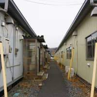 Temporary housing units stand in Ishinomaki, Miyagi Prefecture, on Feb. 19. Some evacuees from the March 2011 quake and tsunami are unable to move to more permanent units due to financial and other concerns. | MAGDALENA OSUMI