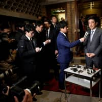 Prime Minister Shinzo Abe speaks to media Thursday evening at the Prime Minister's Office in Tokyo following his telephone conversation with U.S. President Donald Trump. The U.S. president met with the North Korean leader, Kim Jong Un, in Hanoi earlier in the day. | REUTERS
