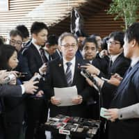 Okinawa Gov. Denny Tamaki speaks to reporters Friday at the Prime Minister's Office after meeting with Prime Minister Shinzo Abe about the result of the prefectural referendum on the relocation plan for U.S. Marine Corps Air Station Futenma. | KYODO