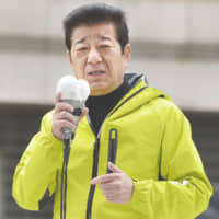 Ichiro Matsui on Sunday makes a stump speech in Osaka on the first day of official campaigning for the April 7 mayoral election. | KYODO