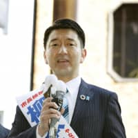 Akira Yanagimoto speaks to voters in Osaka on Sunday, the first day of campaigning for the April 7 mayoral election. | KYODO