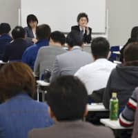 People in the nursing care industry attend a briefing session in Nagoya in March when health ministry officials explained about the new visa system. The program will come into effect Monday. | KYODO