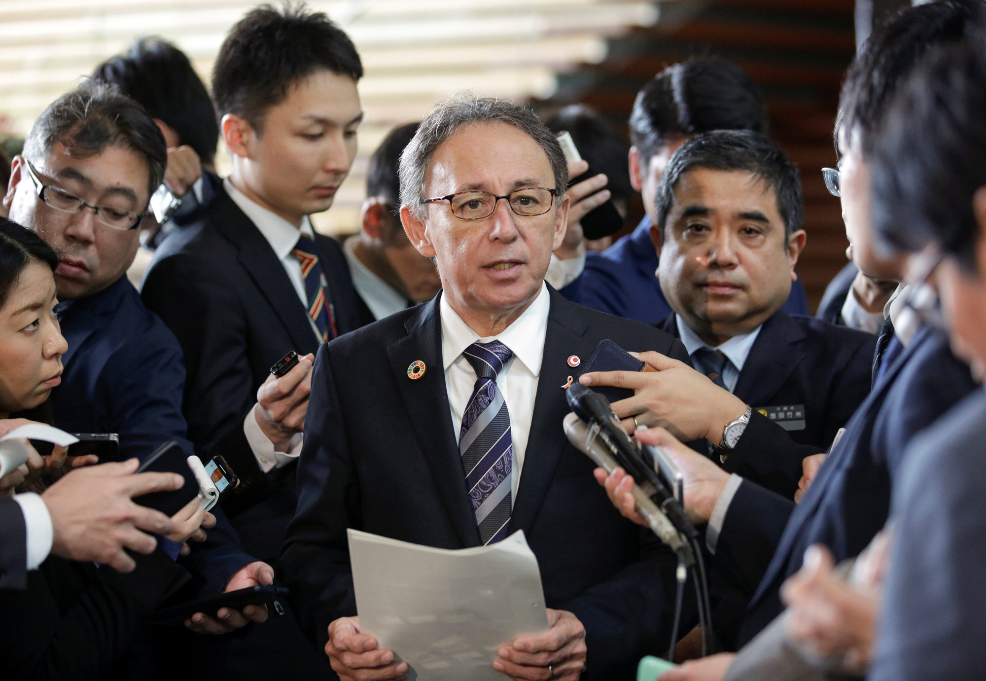 Okinawa Gov. Denny Tamaki speaks to the media after a meeting with Prime Minister Shinzo Abe at the Prime Minister's Office in Tokyo on March 1. | REUTERS