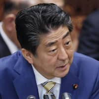 Prime Minister Shinzo Abe speaks at the Upper House budget committee Thursday. | KYODO