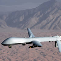 The U.S. Air Force MQ-1 Predator unmanned aircraft is one of the weapons whose development has prompted global concerns over humanitarian and ethical issues. | REUTERS / VIA KYODO