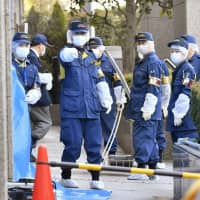 U.S. man arrested over stabbing death of Japanese wife in lobby of Tokyo court building