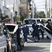Woman stabbed to death in Tokyo apartment; police seek male suspect seen near site