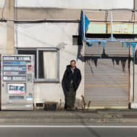 Emil Truszkowski stands on a street in the town of Namie, Fukushima Prefecture, where the evacuation order was partially lifted in 2017, on Jan. 17. | COURTESY OF EMIL TRUSZKOWSKI