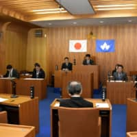 Members attend an assembly session of the village of Kitayama in Wakayama Prefecture on Tuesday. | KYODO