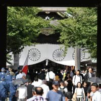 Hong Kong protesters plead not guilty to trespassing at Tokyo's war-linked Yasukuni Shrine