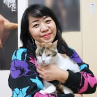 New friends: Edleen Guanko adopted Chapuche (now named Chie) and her best friend Chijimi (now named Fujimi) after they were both featured in The Japan Times. | EDLEEN GUANKO