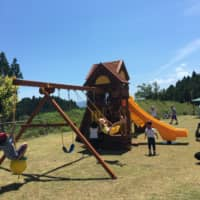 Playground of Hope has constructed a set of swings and a slide for children to enjoy in a park in the village of Omuro in Ishinomaki, Miyagi Prefecture. | COURTESY OF PLAYGROUND OF HOPE