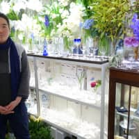 Tatsuro Ohno sells flowers, old Baccarat crystal glassware and Royal Copenhagen porcelain at a boutique in Ginza. | ALEX MARTIN