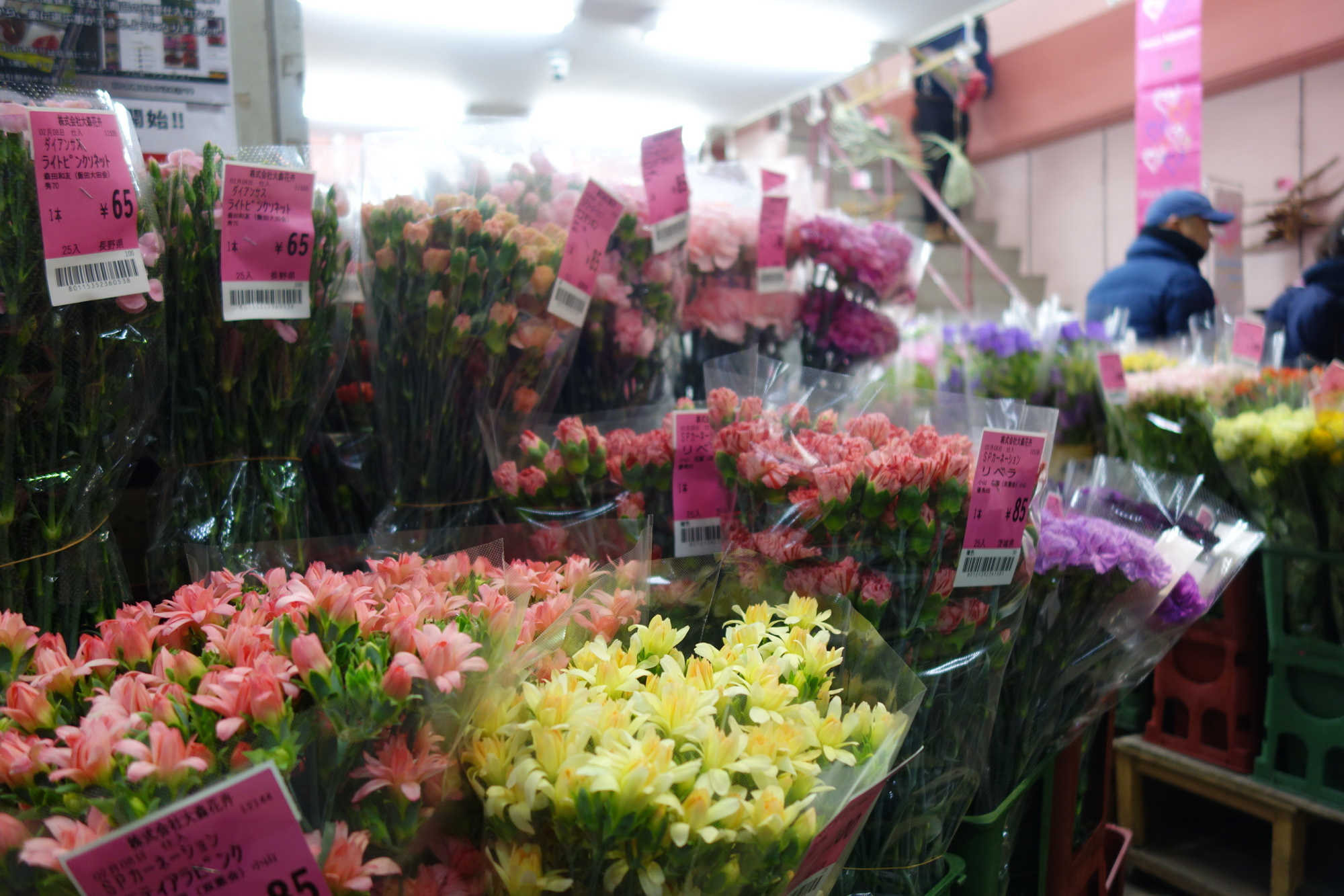 The price tags on the bundles of colorful blooms crowding the storefronts at Ota Shijo are markedly cheaper than what's seen in commercial stores.