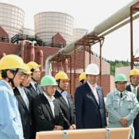 Prime Minister Shinzo Abe visits a geothermal power plant in the town of Yanaizu, Fukushima Prefecture. | KYODO