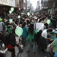 People dance during a St. Patrick's Day parade in Yokohama's Motomachi district in 2018. | COURTESY OF HIDEKI MIMURA