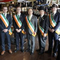 Organizers of the St. Patrick's Day parade in Yokohama's Motomachi district pose for a group photo in 2018. | COURTESY OF HIDEKI MIMURA