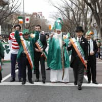 Participants stand on Omotesando-dori during a St. Patrick's Day parade in Tokyo in 2018. | COURTESY OF IRISH NETWORK JAPAN TOKYO
