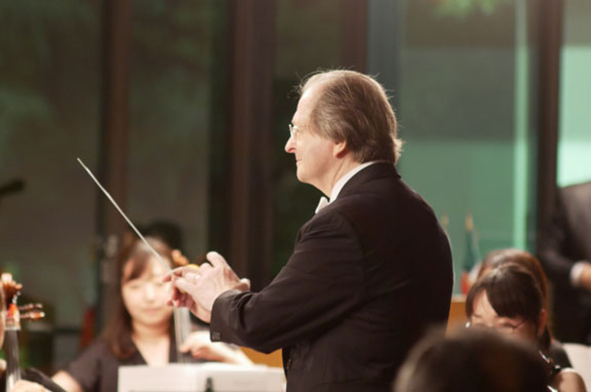 Waving the baton: Robert Ryker founded Tokyo Sinfonia in 2006 after years of playing the tuba and conducting other orchestras. By making changes to classical works, he is able to provide a new take on well-known compositions with the Sinfonia's 19 members. | COURTESY OF TOKYO SINFONIA