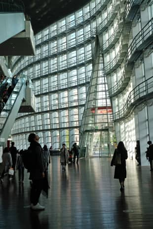 In praise of shadows: Visitors gaze up at the architectural marvel that is The National Art Center, Tokyo.