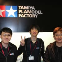 Ready to play: Store manager Takamichi Hangai (right), with colleagues Shogo Okawa (center) and Toru Kondo (left) always take note of customer requests and ideas at the Tamiya Plamodel Factory in the Shinbashi district of Tokyo. | KYODO