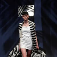 A model shows off a PVC dress from the collection. | REUTERS