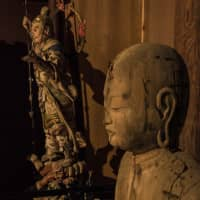 Ancient gloom: Faces appear out of the darkness of Hagaji temple. | STEPHEN MANSFIELD