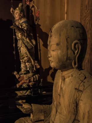 Ancient gloom: Faces appear out of the darkness of Hagaji temple.