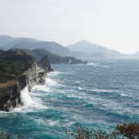 World's end: Not far from La Posada is the Dogashima coast, where turquoise waves crash against rocky cliffs. | NICK SINCLAIR
